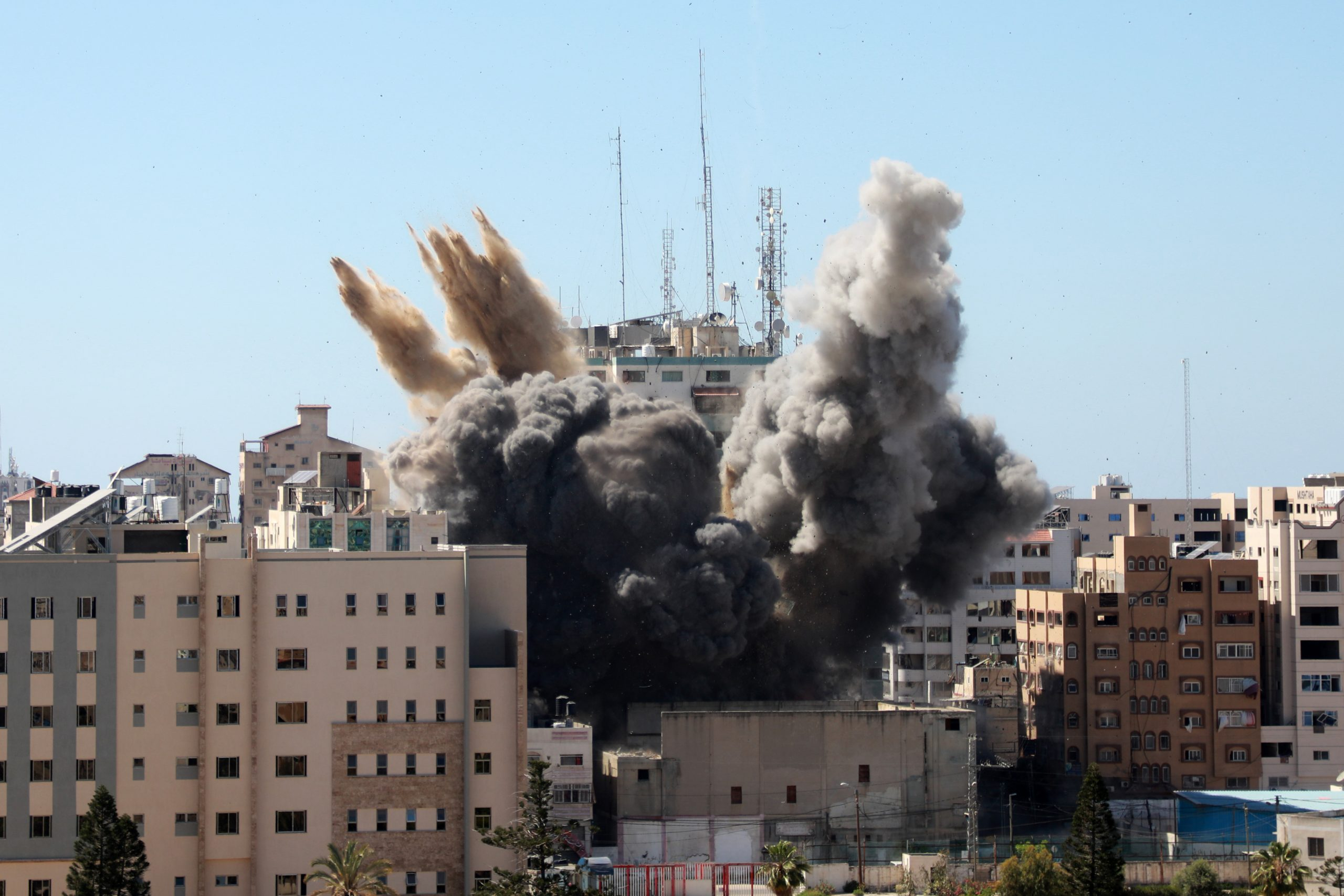 Smoke rising from Jala Tower, the offices of Associated Press (AP) and Al-Jazeera in Gaza, after it was hit in an airstrike..